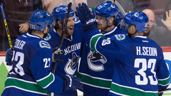 NHL: Oilers 2, Canucks 3 (OT)