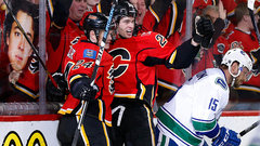 Flames finish off Canucks, continue magical ride