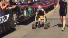 Must See: Eight-year-old with Cerebral Palsy finishes triathlon