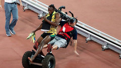 Must See: Bolt gets taken out by cameraman on Segway