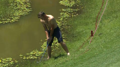 Must See: Golfer strips down, duffs shot