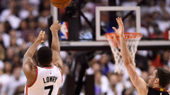 Lowry, Valanciunas push Raptors past Heat in OT