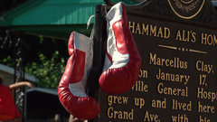 Thousands gather in front of Ali's childhood home